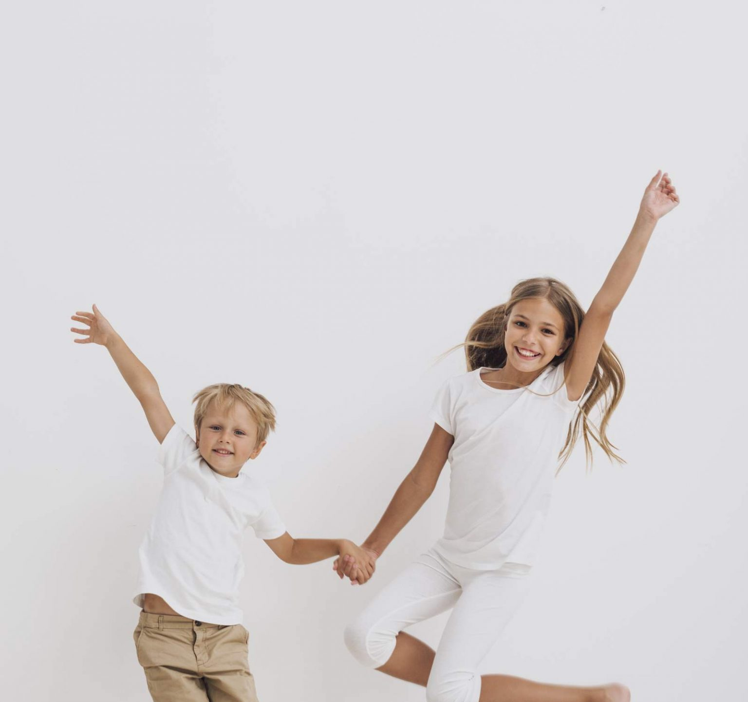 Kids Jumping in the Air on White Background