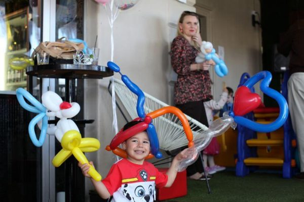 child showing balloon twisting