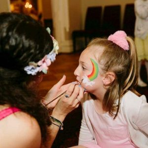 Child having their face painted by a fairy face painter Melbourne