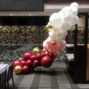 Pink and white balloon garland